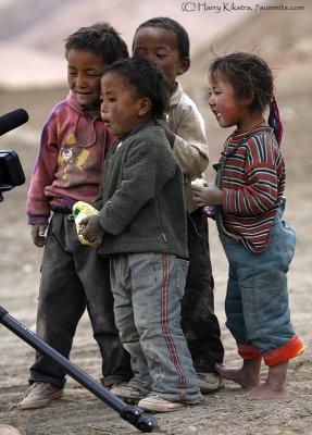 [kids looking at their own film]